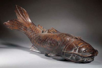 A large wood model of a carp 1