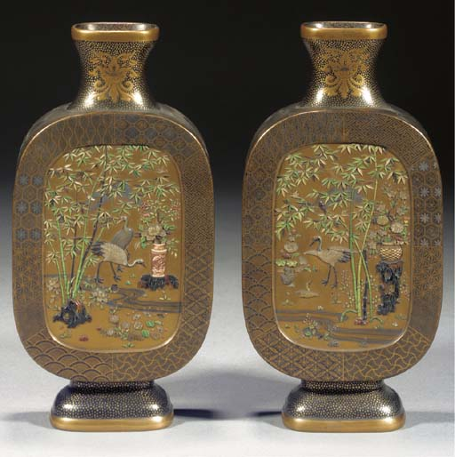 A pair of gold and lacquer shi