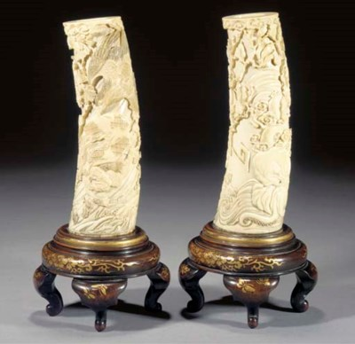 A pair of ivory tusk vases 19t