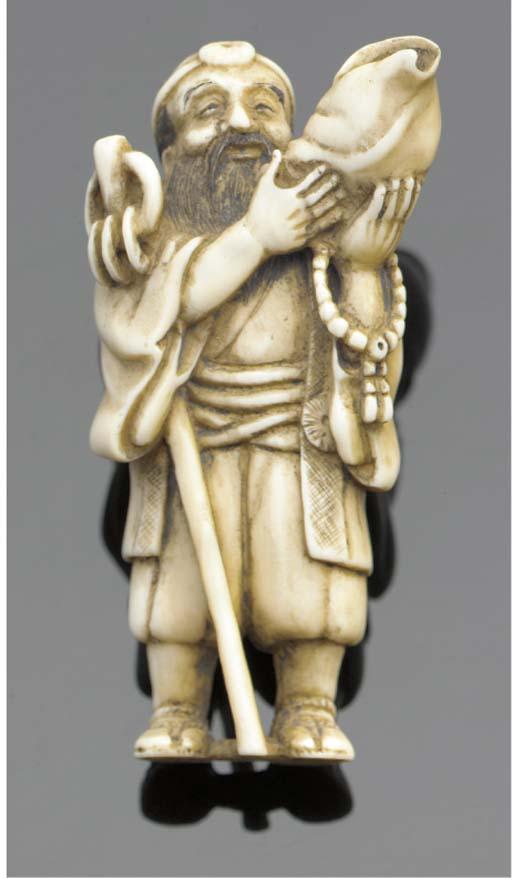 An ivory netsuke of a man with