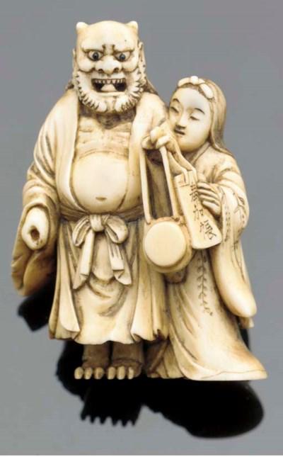 An ivory netsuke of an oni and