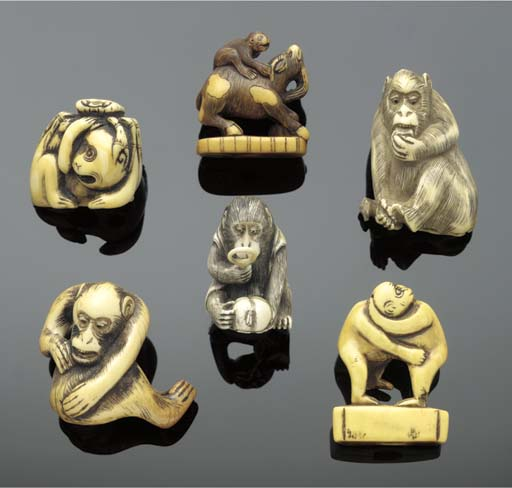 An ivory netsuke of two monkey