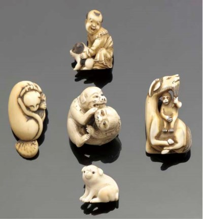 An ivory netsuke of a recumben