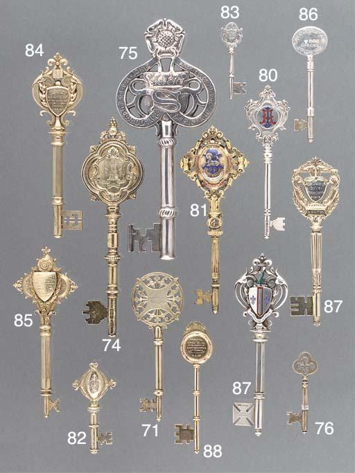 Five Various Silver-Gilt Prese
