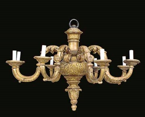 A carved and gilded wood and c