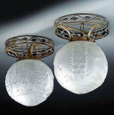 A pair of moulded glass and gi