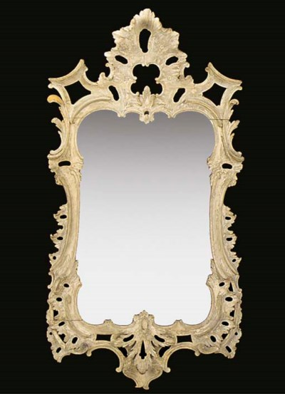 A DECORATED CARVED MIRROR