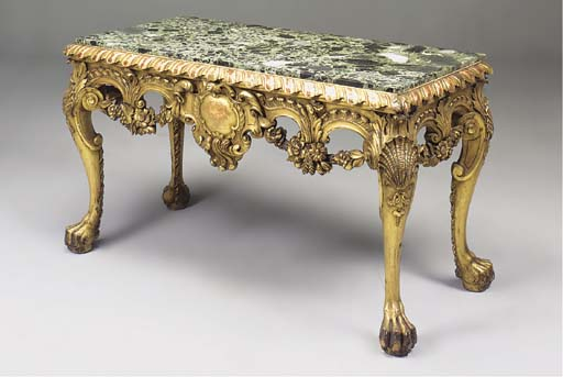 A CARVED GILTWOOD MARBLE TOP S