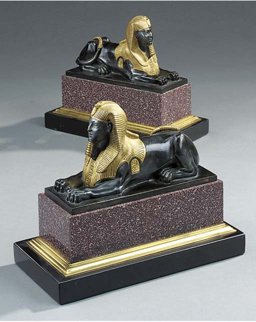 A pair of parcel gilt bronze a