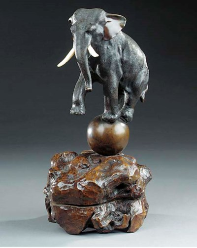 A Japanese bronze and ivory mo