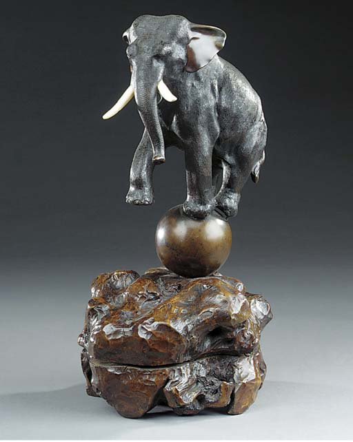 A Japanese bronze and ivory mounted model of an elephant