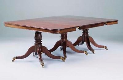 A mahogany three-pedestal dini