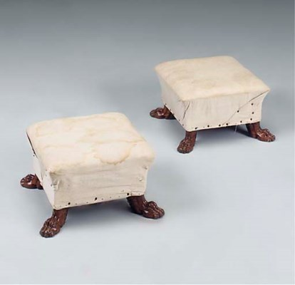 A PAIR OF WALNUT FOOTSTOOLS