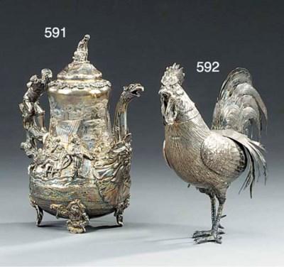 A silver model of a cockerel