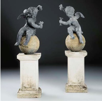A pair of lead models of putti