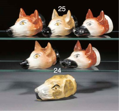Two Staffordshire pottery fox-