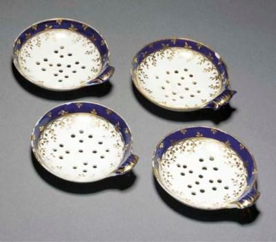 Four English porcelain straine