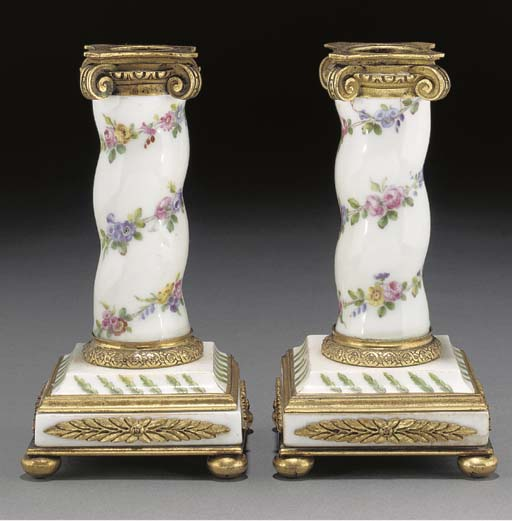 A pair of Sevres-style sectional porcelain and gilt-metal mounted candlesticks