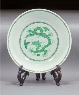 A green and white enameled saucer dish  18th century, underg