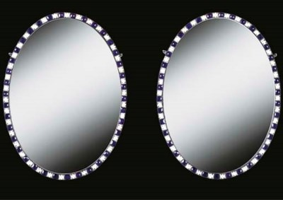 A PAIR OF OVAL WALL MIRRORS