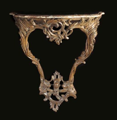 A FRENCH CARVED OAK AND MARBLE