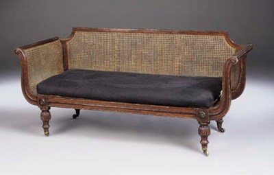 A MAHOGANY AND CANED SOFA