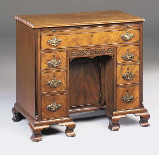 A MAHOGANY KNEEHOLE DESK