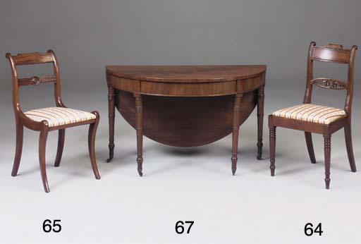 A circular mahogany side table