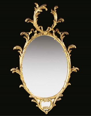 A GILTWOOD OVAL WALL MIRROR