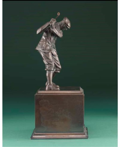 A SPELTER FIGURE OF A GOLFER