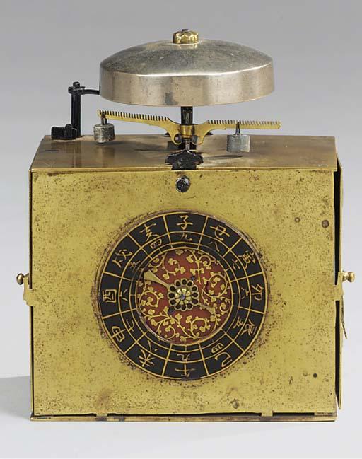 A Japanese brass pillow clock