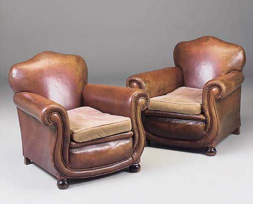 A TAN LEATHER UPHOLSTERED THRE