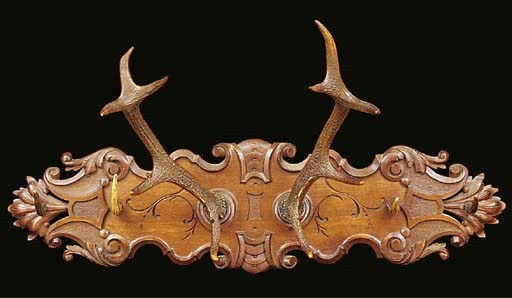 A Continental carved wood and