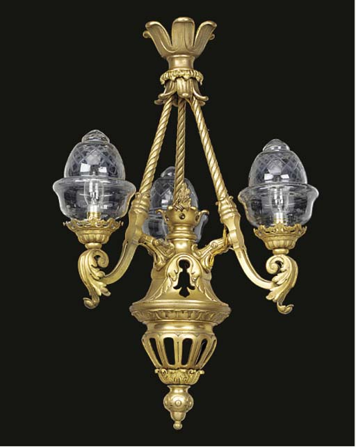 A gilt bronze three light gaso