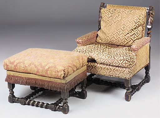 A CARVED OAK ARMCHAIR AND MATC