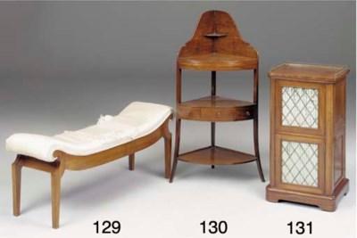 A mahogany bedside cupboard