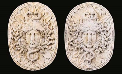 A PAIR OF CARVED AND WHITE PAI