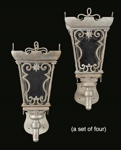 A set of four wrought iron lan