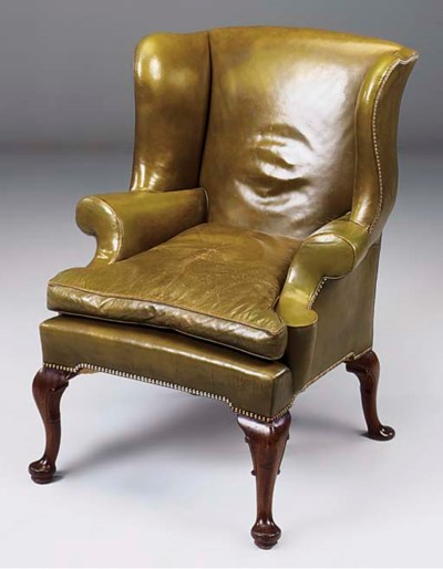 A MAHOGANY LEATHER UPHOLSTERED