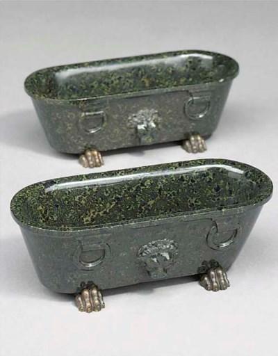 A pair of serpentine green mod