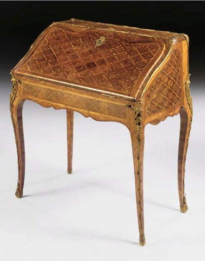 A LOUIS XV ORMOLU MOUNTED KING