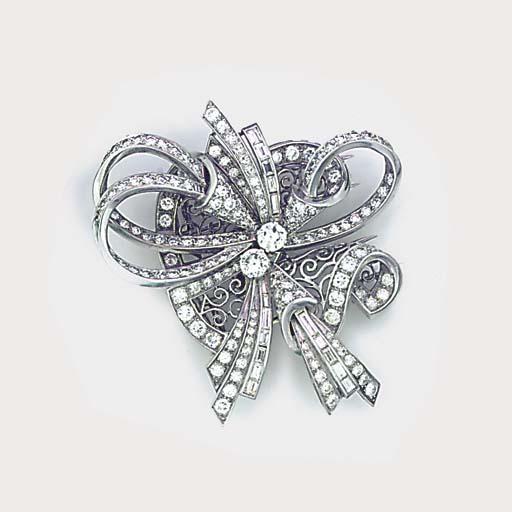 A diamond double clip brooch,