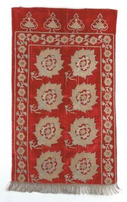 An embroidered velvet yastik,