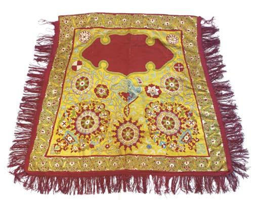 An embroidered saddle cover, e