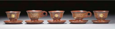 A group of five Topane cups an