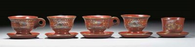 A group of four Topane cups an