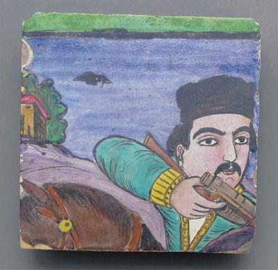 A large Qajar tiled panel, 19t