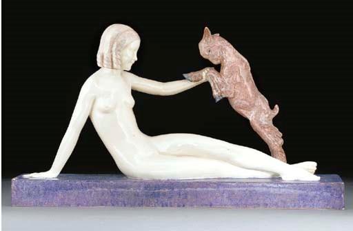 A polychrome earthenware figur