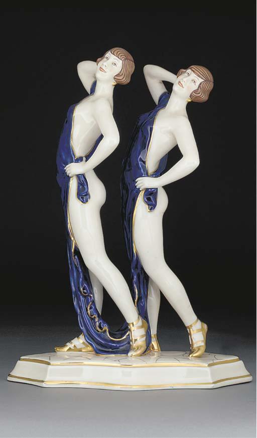 A gilt porcelain figural group