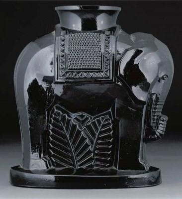 A moulded black glass vase